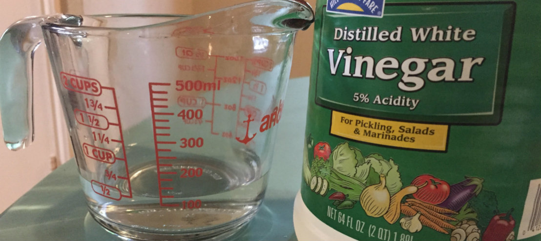 Measured out vinegar to pour into a condensate drain
