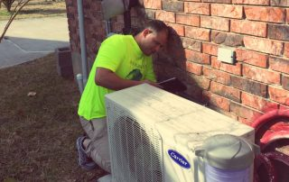 HVAC technician working on a mini-split HVAC system