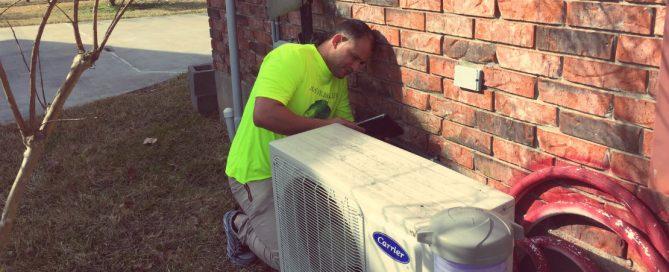 HVAC technician working on a mini-split HVAC system
