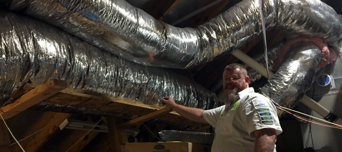 Rob inspecting duct work in attic