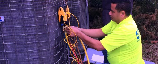 Jose checking the refrigerant charge on an outdoor condensing unit