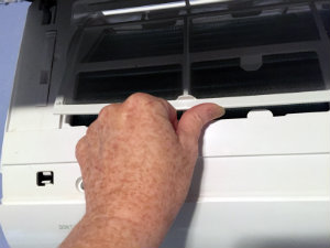 HVAC ductless unit - set the filter behind the plastic tabs