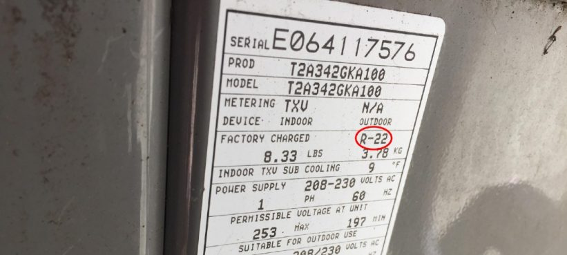 Tag on condenser showing type of refrigerant