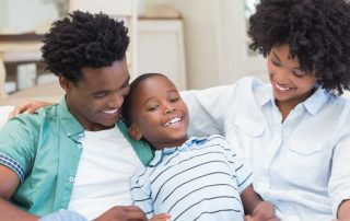 Happy African-American family comfortable in their home