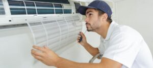 HVAC technician conducts hvac maintenance on a mini split HVAC system